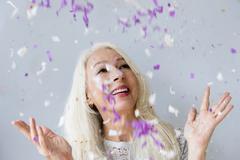 Caucasian woman throwing confetti Kuvituskuvat
