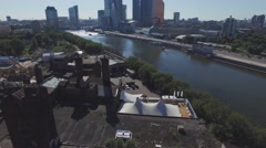 Quadrocopter shoot roof of summer restaurant in Moscow city at Moscow river in Stock Footage