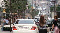 People walk by the street in the Gangnam district in Seoul, Korea. Stock Footage