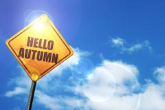 Yellow road sign with a blue sky and white clouds: hello autumn - stock illustration
