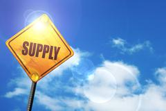 Yellow road sign with a blue sky and white clouds: supply - stock illustration