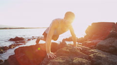 Push ups fitness man exercising push-ups on beach - Healthy active living Stock Footage
