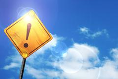 Yellow road sign with a blue sky and white clouds: Hazard warnin - stock illustration