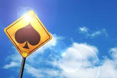 Yellow road sign with a blue sky and white clouds: Spade card ba Stock Illustration