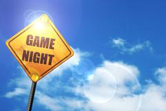 Yellow road sign with a blue sky and white clouds: Game night si - stock illustration