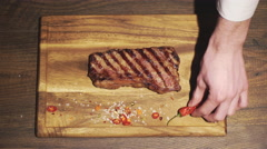 Chef prepares a beef steak dish in a restaurant kitchen. Close up Stock Footage