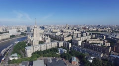 Quadrocopter fly over Moscow city in summer cloudless day. Center. Building of - stock footage