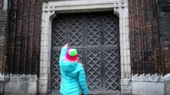 Little girl walks around Basilica in Gdansk Stock Footage