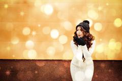 Indoor lifestyle Fashion portrait of a young woman brunette wearing a white Stock Photos