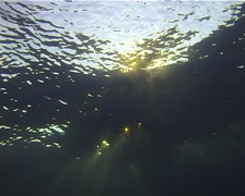 Ocean scenery surface from below, sunbeams, on water surface, at sunset, UP11030 - stock footage