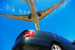 Car and aeroplane Stock Photos