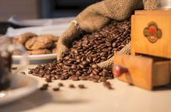 Coffee beans in burlap sack with coffee grinder Stock Photos
