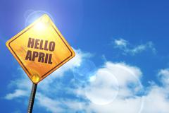 Yellow road sign with a blue sky and white clouds: hello april Stock Illustration