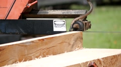 Large Bandsaw Cutting Some Lumber Stock Footage