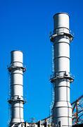 Industrial chimneys Stock Photos