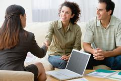 Couple talking to a financial advisor - stock photo