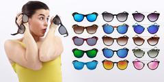 fun woman with sunglasses, sale concept - stock photo
