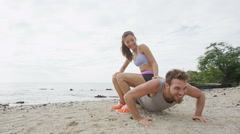 Fitness friends laughing having fun together on beach during workout Stock Footage