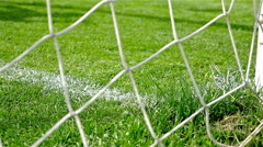 Football game. Soccer action. Goal keeper jumping, ball entering in the goal Stock Footage