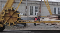The big wheel of rail crane with two workers background Stock Footage