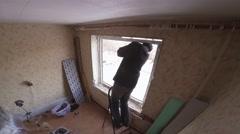 Master warms window of polyurethane foam. 4K. Stock Footage