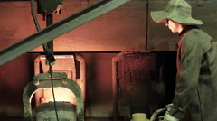 Iron casting with heated container and professional worker Stock Footage