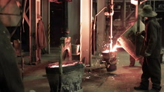 A foundry plant workers pour metal Stock Footage