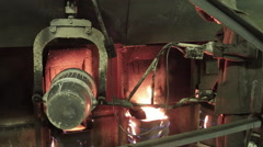 Worker in the foundry plant pour the metal - stock footage