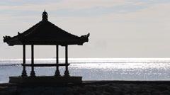 Gazebo on the tropical beach during sunrise. Sanur, island Bali, Indonesia Stock Footage