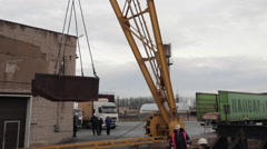 Rail crane moves a leaky container in the load zone - stock footage