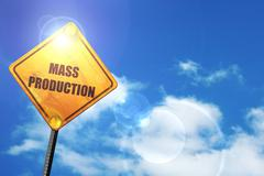 Yellow road sign with a blue sky and white clouds: mass producti Stock Illustration
