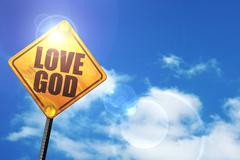 Yellow road sign with a blue sky and white clouds: love god - stock illustration