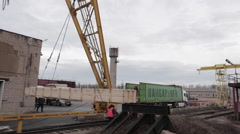 Loading operations with rail crane in the dock Stock Footage