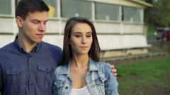 Fashion couple embracing and looking aside on villa background. 4k. Stock Footage