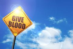 Yellow road sign with a blue sky and white clouds: give blood - stock illustration