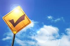Yellow road sign with a blue sky and white clouds: Approved tick - stock illustration