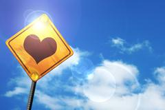 Yellow road sign with a blue sky and white clouds: Hearts card b - stock illustration