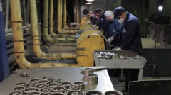 Workers  the assembly workshop make metal parts for pumps - stock footage