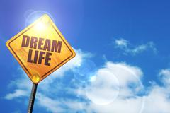 Yellow road sign with a blue sky and white clouds: dream life - stock illustration