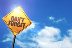 Yellow road sign with a blue sky and white clouds: don't forget Stock Illustration