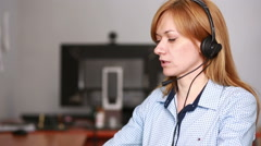 Female customer support operator. she leads online consultation using web camera - stock footage