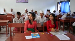 Indonesian girls and boys in a local school during the lesson, Bali Stock Footage