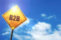 Yellow road sign with a blue sky and white clouds: b2b - stock illustration