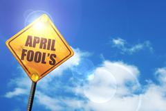 Yellow road sign with a blue sky and white clouds: april fool's Stock Illustration
