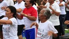 Balinese people training on laughter therapy and yoga classes and dance - stock footage