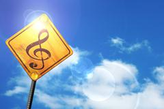 Yellow road sign with a blue sky and white clouds: Music note ba - stock illustration