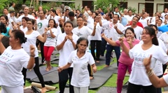 Stock Video Footage of Balinese people training on laughter therapy and yoga classes and dance