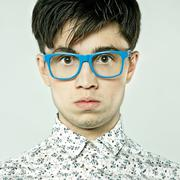 Caucasian man wearing colorful eyeglasses Stock Photos