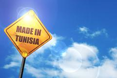 Yellow road sign with a blue sky and white clouds: Made in tunes - stock illustration