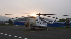 Silhouette of helicopter Mi-8MTV at sunset in Nepal Stock Footage